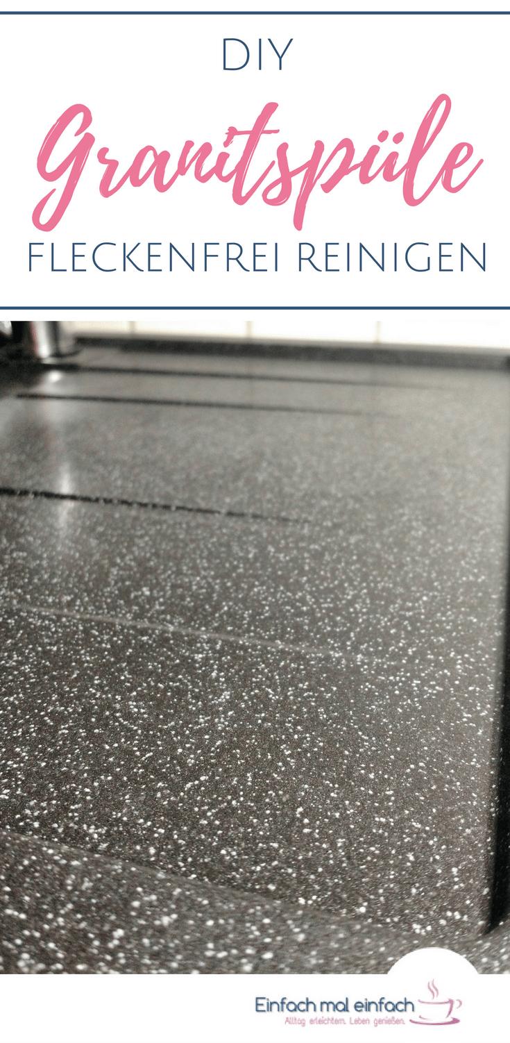 """Saubere dunkle Granitspülenablage. Text:""""DIY Granitspüle fleckenfrei reinigen."""""""