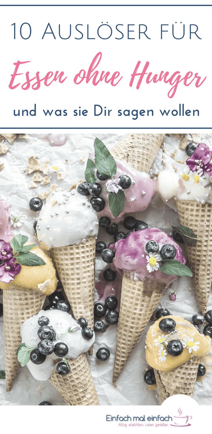 """Eiscreme-Hörnchen mit bunten Kugeln, Beeren und Blüten auf hellem Untergrund. Text:""""10 Auslöser für Essen ohne Hunger und was sie Dir sagen wollen."""""""