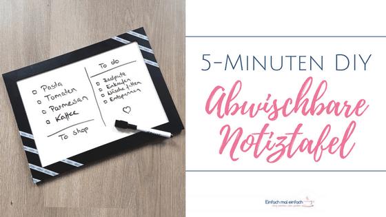 """Notiztafel aus Bilderrahmen mit Stift auf Holzuntergrund. Text:""""5-Minuten DIY Abwischbare Notiztafel."""""""